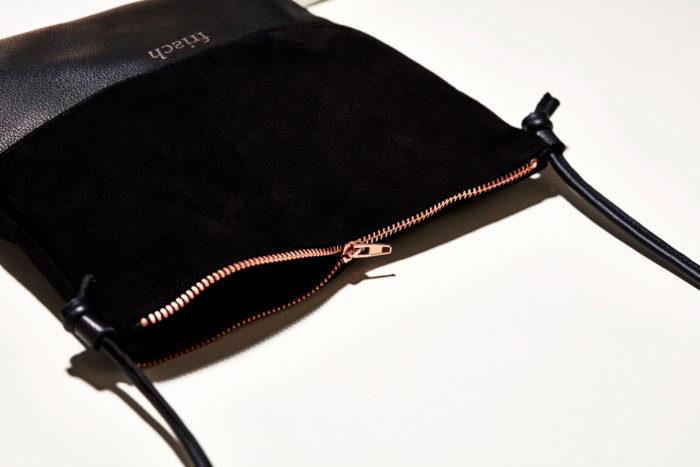 Schwarze Handtasche mit Kupfer Reißverschluss