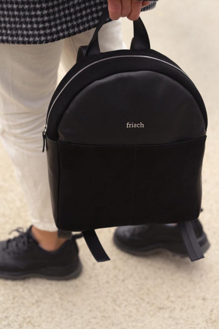 Lederrucksack in schwarz zu sportlichem Outfit