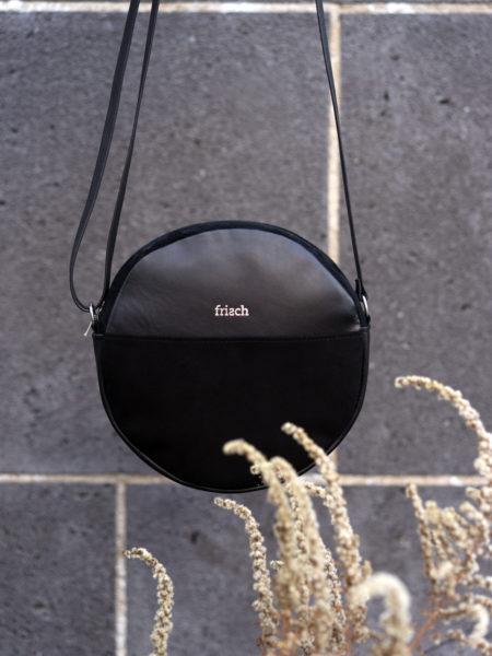 Runde Handtasche aus nachhaltigem Leder in schwarz